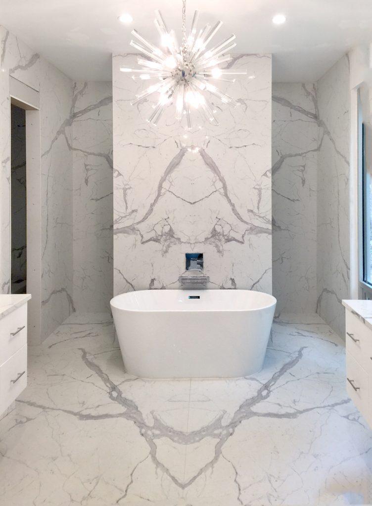 Luxury marble bathroom renovation with stand alone bathtub