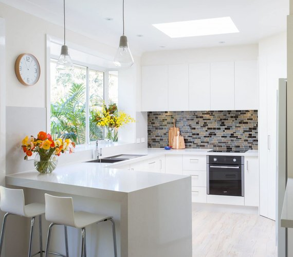 White Kitchen Renovation with White Benchtop Resurfacing Sydney Granite Transformations